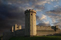 Warwick castle under moody skies Stock Photos