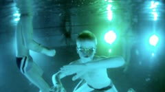 Boy swims under water in pool with swimming goggles - stock footage
