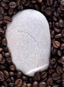 coffee beans and stone - stock photo