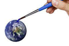 Colouring blue planet earth Stock Photos