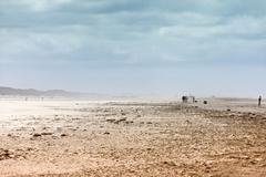 Ethereal landscape of a beach during sand storm - stock photo