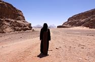 Nomadic woman with Burka in the desert Stock Photos