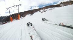 Skier goes on ski route lengthways mountain rope hoist Stock Footage