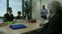 Pan of boardroom meeting Stock Footage