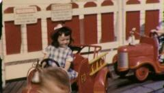 Girl Firetruck AMUSEMENT PARK RIDE Kids 1950s (Vintage Retro Home Movie) 5144 Stock Footage