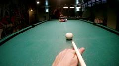 Man begins game on billiards striking by cue on billiard balls Stock Footage
