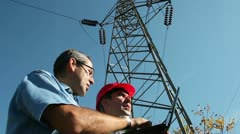 Electricians Under the High Voltage Tower - stock footage