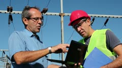 Engineers at High Voltage Substaion Stock Footage