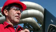Engineer Inside Oil and Gas Refinery Using Laptop Stock Footage