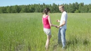 Stock Video Footage of guy with girl holding hands also run across field