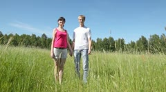 Guy with girl to hold hands and smile to sun Stock Footage
