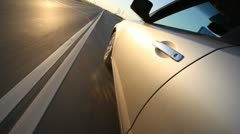Cars going towards to car and driver with passenger in it Stock Footage