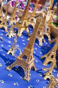 Miniature eiffel tower souvenirs selling in market, paris, france Stock Photos