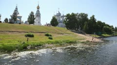 Vologda river bank with bathing people and several temples Stock Footage