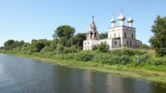 Ioann Zlatousta church with silvery domes on bank of river Stock Footage