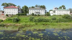Buildings of city of Vologda on river bank Stock Footage