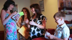 Girls read costing to inscription on leaflets of playing game Stock Footage
