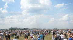 Audience waits parade of planes on air show Stock Footage