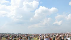 Spectators looks parade of planes on air show Stock Footage