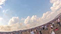 People look an air show on airfield in sunny weather Stock Footage