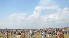 Audience photographs parade of planes on air show Stock Footage