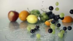 Grapes falling on glass surface, slow motion shot at 480fps HD Stock Footage