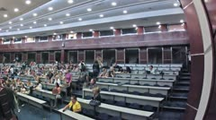 Young people communicate in auditorium on  Youth Voice Stock Footage