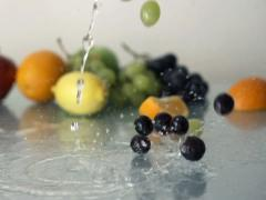 Grapes falling on glass surface NTSC Stock Footage