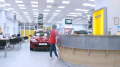 Woman stands near reception of Automobile Dealership Automir Stock Footage