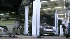 Mechanics repair car in car-care center. Stock Footage