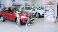 Suzuki Sx4 stands in motor show of Automobile Dealership Automir Stock Footage