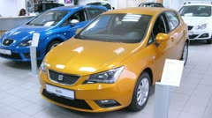 Car Seat Ibiza stands in motor show, indoor Stock Footage