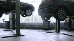 Mechanics repair car in garage of Automobile Dealership Automir Stock Footage