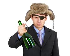 Russian business man in hat earflaps, offers to drink alcohol Stock Photos