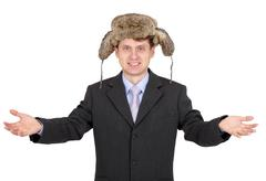 hospitable funny man with a fur hat - stock photo