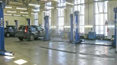 Cars stands in garage of service center, time lapse Stock Footage