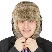 Russian businessman in fur hat on white background Stock Photos