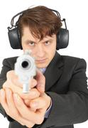 Businessman aiming a gun, on  white background Stock Photos
