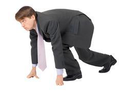 Businessman ready to compete on white background Stock Photos