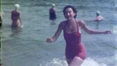 Happy WOMAN RUNS From Sea Ocean Beach Summer 1950s Vintage Film Home Movie 5167 Stock Footage