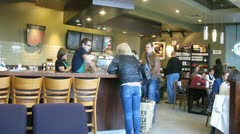 Several people sit in coffee house Starbucks. Stock Footage