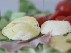 Pouring olive on mozzarella and food, slow motion shot at 480fps NTSC Stock Footage