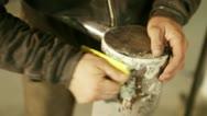 Handling abrasive metal surface Stock Footage