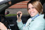 Close up portrait of female driver with car key in hand Stock Photos
