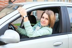 woman with blond hair in land vehicle - stock photo