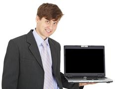 friendly smiling person holds laptop on hand - stock photo