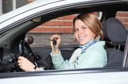 Portrait of female driver with car key in hand Stock Photos