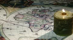 Candle, Gold compass, old map Stock Footage