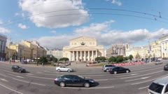 Stream of cars goes in front of Bolshoi Academic theater Stock Footage