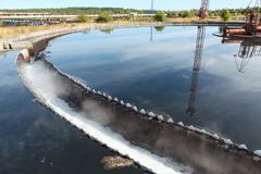 industrial round sedimentation reservoir of wastewater treatment - stock photo